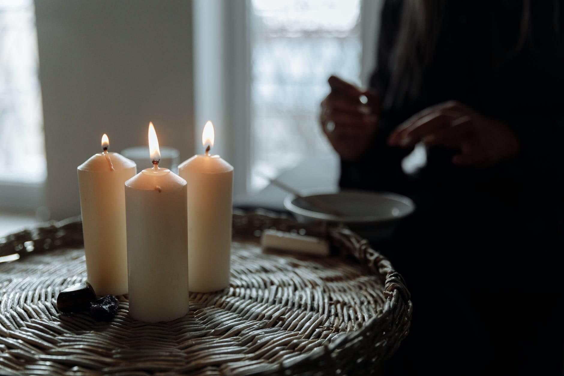white pillar candles on brown woven basket